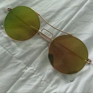 Round gold reflective sunglasses